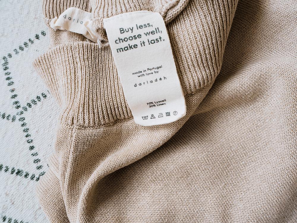 Label of fair fashion garment that sais buy less, choose well, make it last