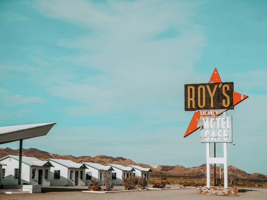 Roy's Motel and Cafe in Amboy Photo picturing the famous road sign and tiny houses as part of the motel
