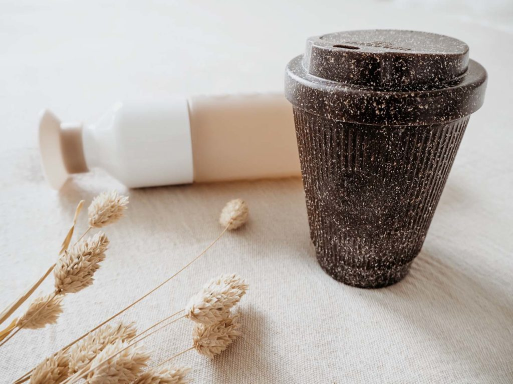 Eco-Friendly travel mug and a reusable water bottle